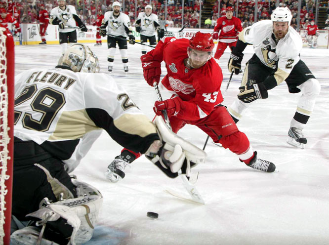 Marc-Andre Fleury made this save on Darren Helm, one of his 27 stops in Game 1. Fleury gave up two goals on strange caroms off the boards behind his net.