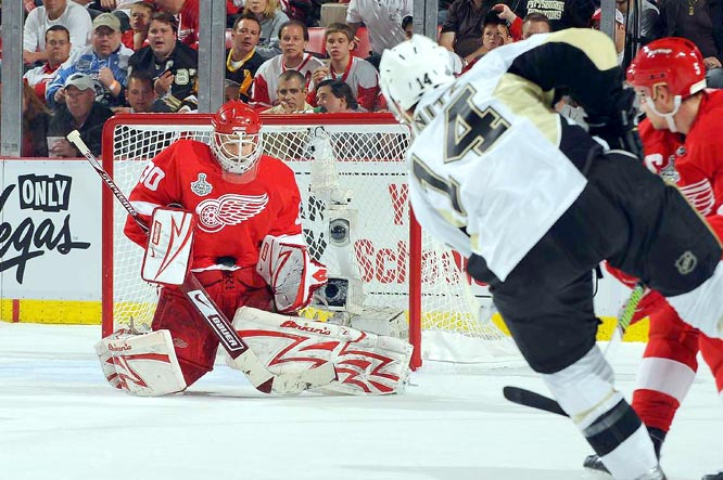 Chris Osgood took this shot in the breadbasket for one of his 31 saves as the Wings took Game 2 at Joe Louis Arena.