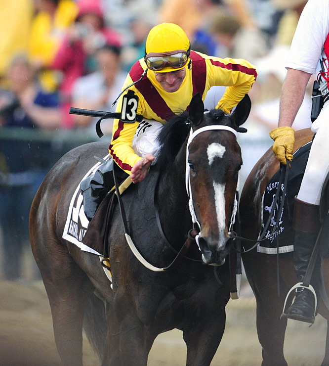 Jockey Calvin Borel couldn't wait to give Rachel Alexandra a much-deserved pat after her Preakness victory.