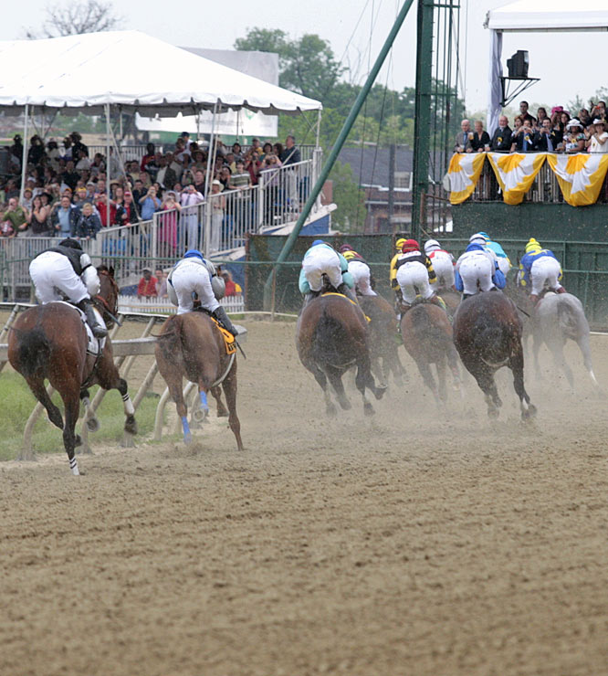 The Pimilico crowd gets a gander at the Preakness field at Turn 1.