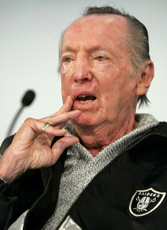 The late Al Davis and the NFL had a love-hate relationship...with not much love. In April 1966, Davis was named commissioner of the AFL, and he quickly started signing the NFL's top quarterbacks. Three months later, the two leagues merged (AFL owners blocked Davis from the meetings), and to Davis' chagrin, NFL commissioner Pete Rozelle was given the top seat. Davis returned to the Raiders, where he took over managing duties and bucked the league at every opportunity. In 1980, Davis attempted to move the Raiders to the L.A. Coliseum without proper league consent. The NFL filed an injunction to block the move, and Davis retaliated with an antitrust suit. Davis eventually won the lawsuit and was awarded $35 million in damages from the league. Adding prideful insult to financial injury, the Raiders won the Super Bowl the following year, forcing Rozelle to present Davis the Vince Lombardi Trophy.