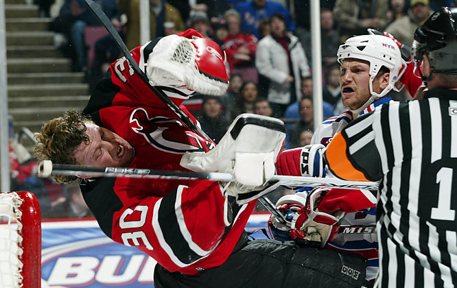 "After taunting Brodeur during the regular season, Avery upped the ante in this feud during the '08 playoffs. During a first-round game, Avery waved his hands and stick in front of Brodeur in an attempt to distract him and block his view. Not illegal at the time, that changed with the advent of the ""Sean Avery Rule."" After the Rangers eliminated the Devils from the playoffs, Brodeur snubbed Avery in the handshake line, causing Avery to remark, ""Fatso forgot to shake my hand."" Since then, Brodeur has referred to Avery as ""the Vogue intern."""