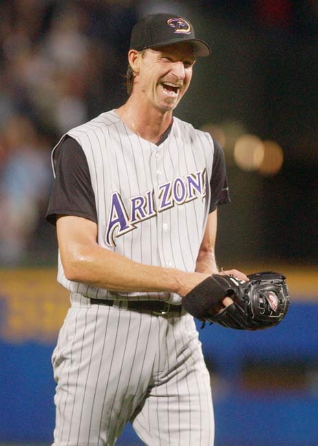 At the age of 40, southpaw Randy Johnson becomes the oldest pitcher to ever throw a perfect game as the Diamondbacks beat the Braves, 2-0. The Big Unit joins Cy Young, Jim Bunning, Hideo Nomo and Nolan Ryan as the only hurlers to throw no-hitters in both leagues and creates the longest time span between no-no's, having first accomplishied the feat against the Tigers in June 1990.