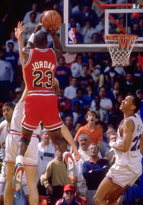 With his team trailing by a point in the deciding game of the Eastern Conference first round playoff series, Chicago's Michael Jordan drives just inside the top of the key and nails an 18-footer over the outstretched fingertips of leaping Cavaliers' defender Craig Ehlo for a 101-100 victory.