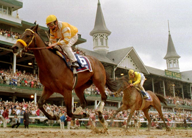At the 120th Kentucky Derby, Chris McCarron rides Go For Gin to victory in 2:03.6.