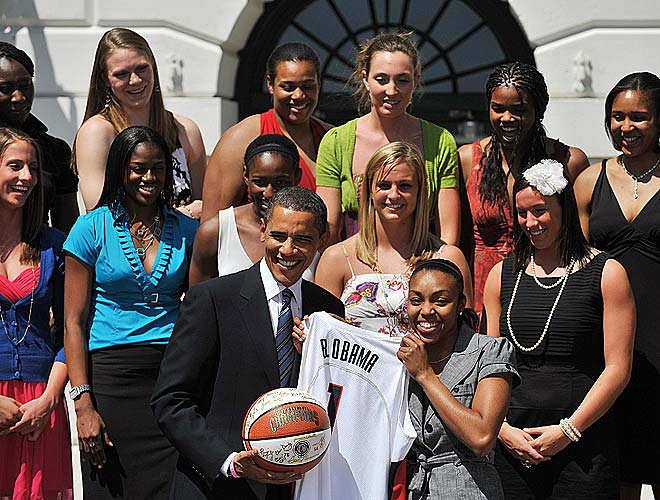 Renee Montgomery beamed as she presented Obama with a custom UConn jersey.
