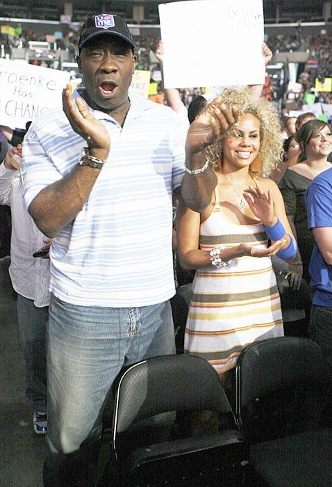 WWE fan Michael Clarke Duncan takes in the action.