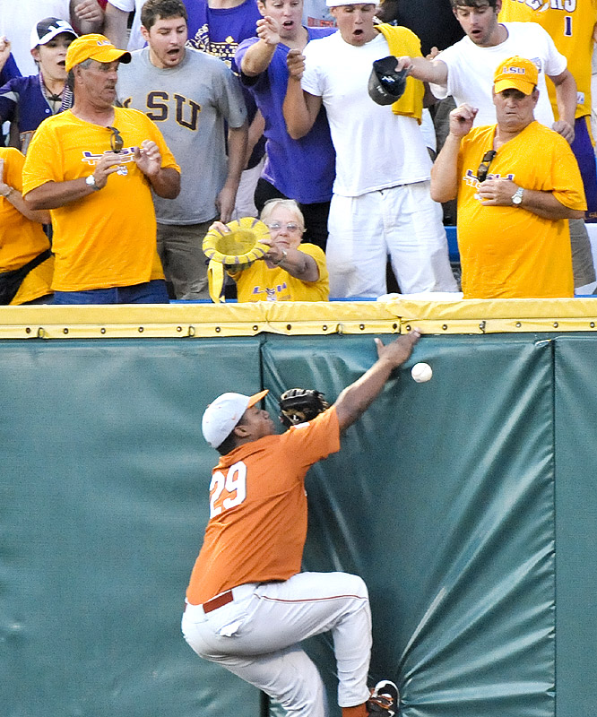 Texas right fielder Kevin Keyes goes all out for the ball hit by LSU's DJ LeMahieu in the third inning.The play went for a triple, but the Tigers didn't score.