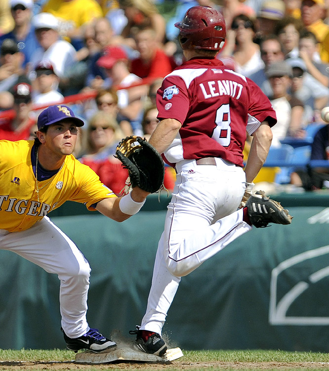 Arkansas' Chase Leavitt (8) beats the throw to first base as LSU first baseman Sean Ochinko waits for the ball. The Tigers won their 13th straight game.