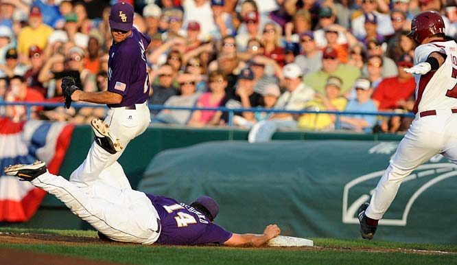 LSU first baseman Sean Ochinko (14) dives to first for the out on Arkansas' Zack Cox.