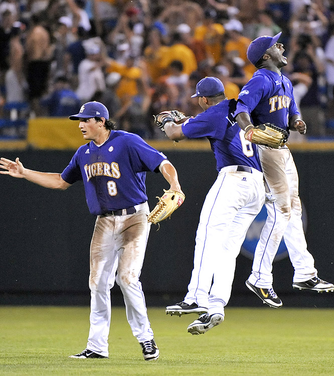 From left, LSU's Mikie Mahtook, Leon Landry and Jared Mitchell celebrate Monday's win. Mahtook singled in the winning run in the top of the 11th inning.
