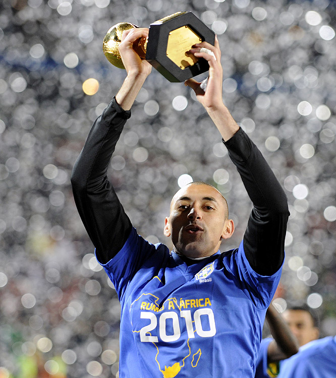 Brazil's Luisao holds up the Confederations Cup trophy after Brazil prevailed at Ellis Park Stadium in Johannesburg, South Africa.