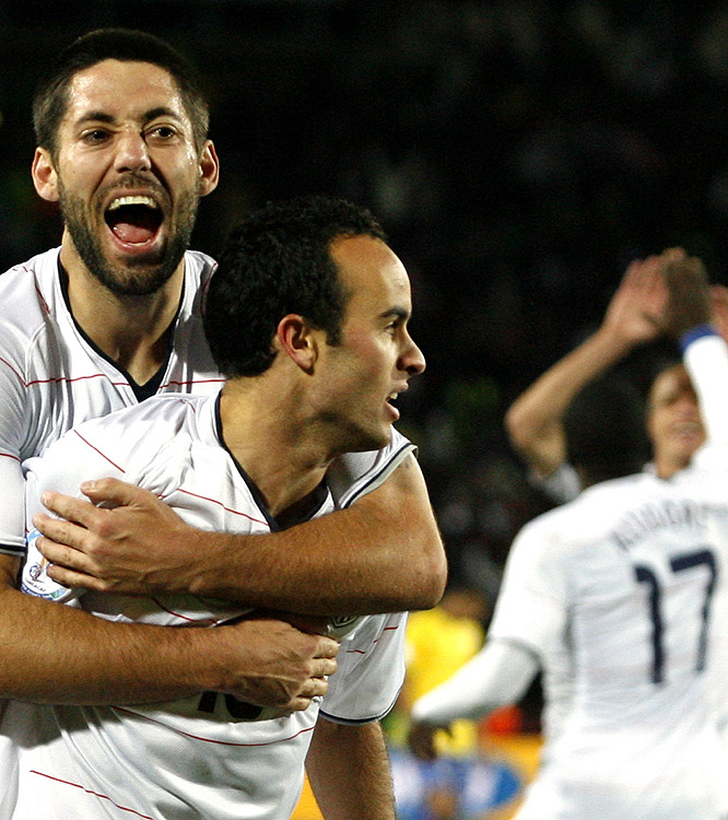 After scoring the first goal, Clint Dempsey (left) congratulates Landon Donovan on his goal while other teammates, including Jozy Altidore (right), join in the celebration.