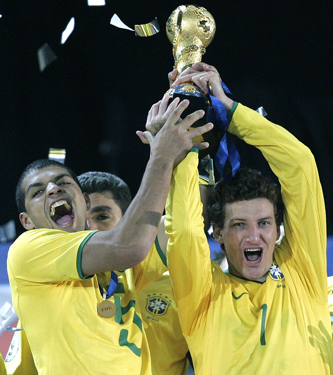 Brazil's Felipe Melo (left) holds up the Confederations Cup trophy with fellow team member Elano. Brazil defeated South Africa 3-2 in the semifinals to reach the title game.