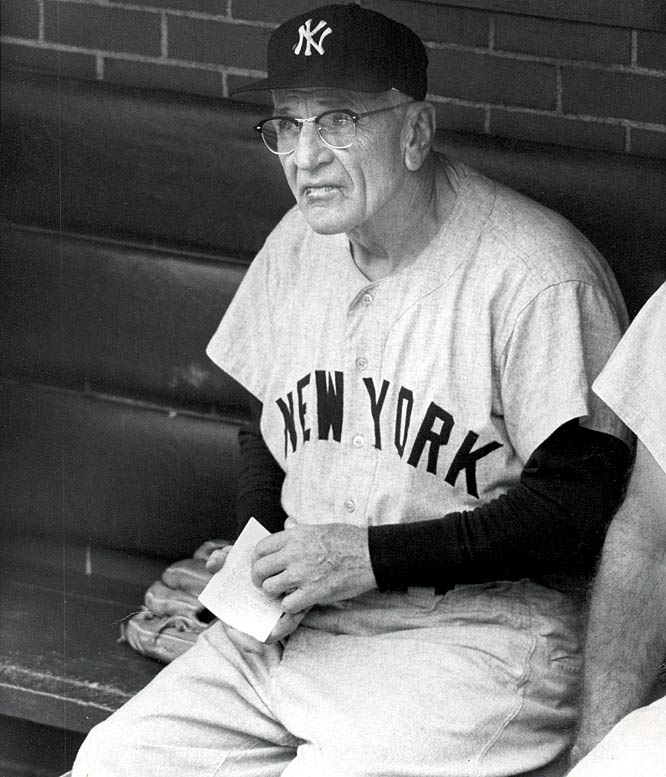 Legendary Yankees manager Casey Stengel takes in the action.
