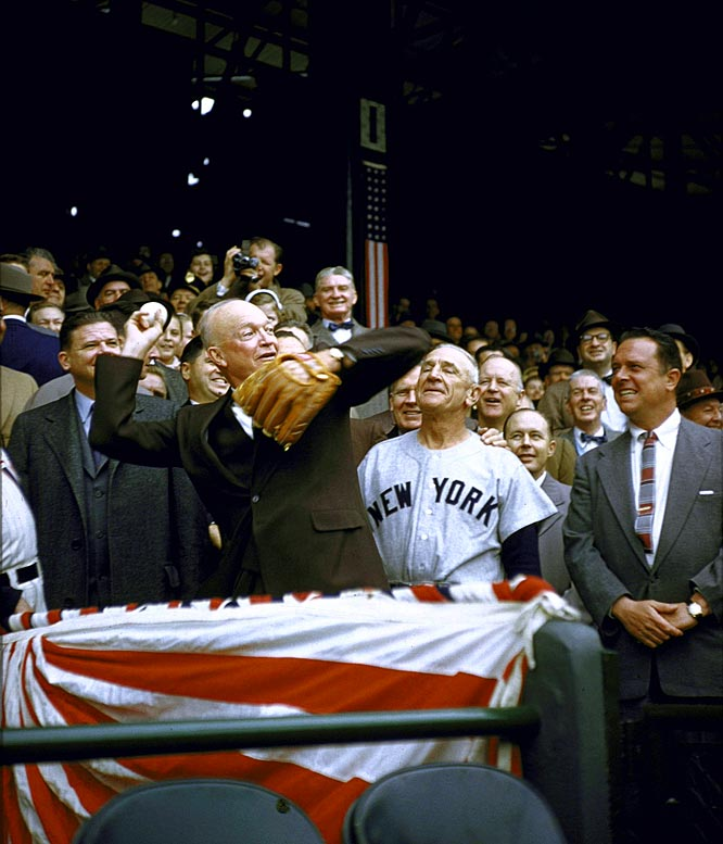 President Eisenhower throws out the ceremonial first pitch on opening day as Casey Stengel looks on.