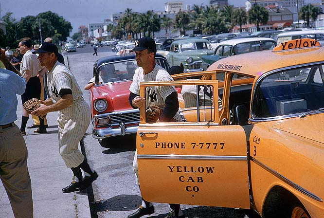 Enos Slaughter and Joe Collins hop out of a cab at Al Lang Field in St. Petersburg.