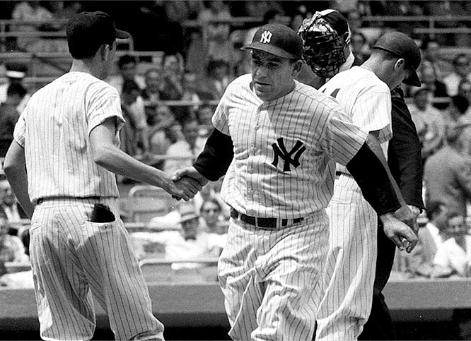 Yogi Berra heads to the dugout after hitting a home run.