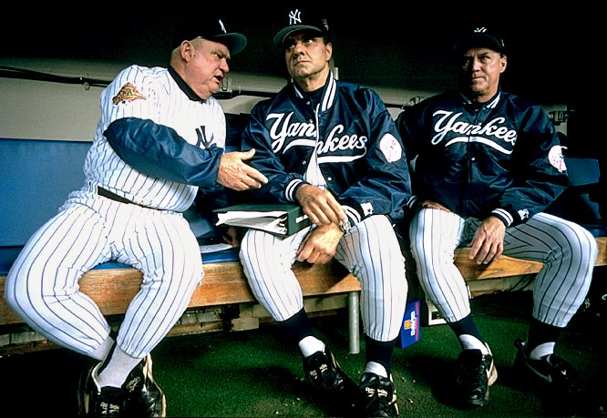 Yankees bench coach Don Zimmer, manager Joe Torre and pitching coach Mel Stottlemyre watch the action from the dugout bench during Game 1 of the World Series against the Braves.