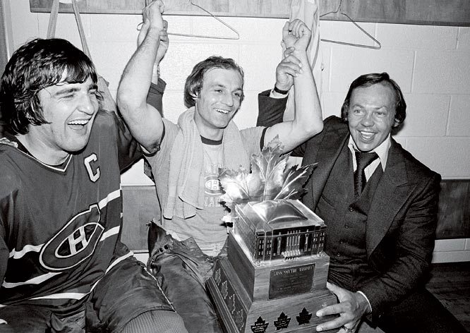Guy Lafleur (center), captain Serge Savard (left) and injured Yvan Cournoyer celebrate in the locker room with Lafleur's Conn Smythe Trophy (playoffs MVP) after defeating Boston in the 1977 Stanley Cup Finals.