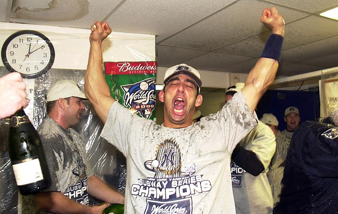 Jorge Posada raises his arms in victory after the Yankees beat the Mets in the Subway World Series.