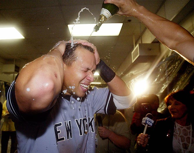 Alex Rodriguez enjoys a champagne bath after the Yankees defeated the Twins in the American League Divisional Series.