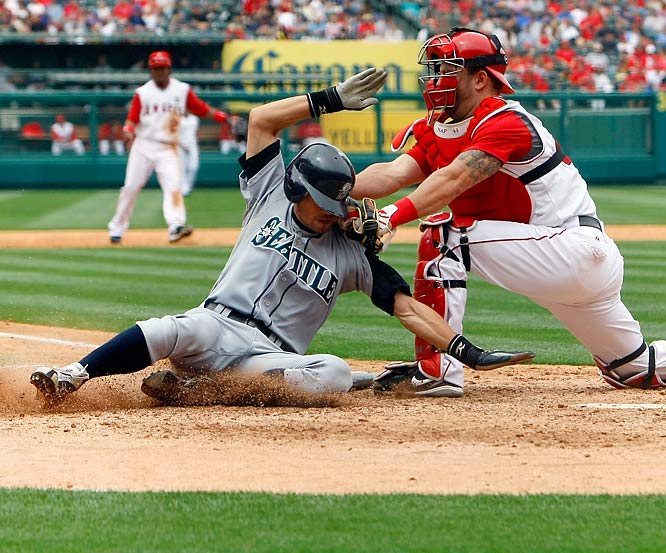 Angels catcher Mike Napoli makes a heads-up play against the Mariners, tagging Ichiro Suzuki out at the plate in the eighth inning of a 9-8 victory by the Angels.