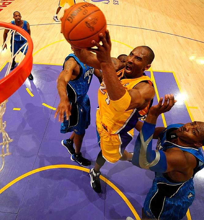Kobe Bryant leaps past Orlando's Dwight Howard during Game 1 of the 2009 NBA Finals. Bryant's 40 points, 8 assists and 8 rebounds carried the Lakers to a 100-75 home-court win, and a 1-0 lead in the NBA Finals.