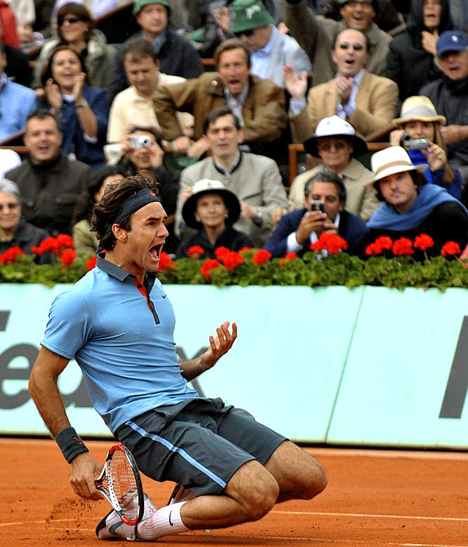 Roger Federer celebrates after defeating Robin Soderling to win his first French Open title, 6-1, 7-6, 6-4. With his near-flawless performance Sunday, the Swiss star became the sixth man to complete a career Grand Slam, and tied Pete Sampras' record of 14 major singles titles.