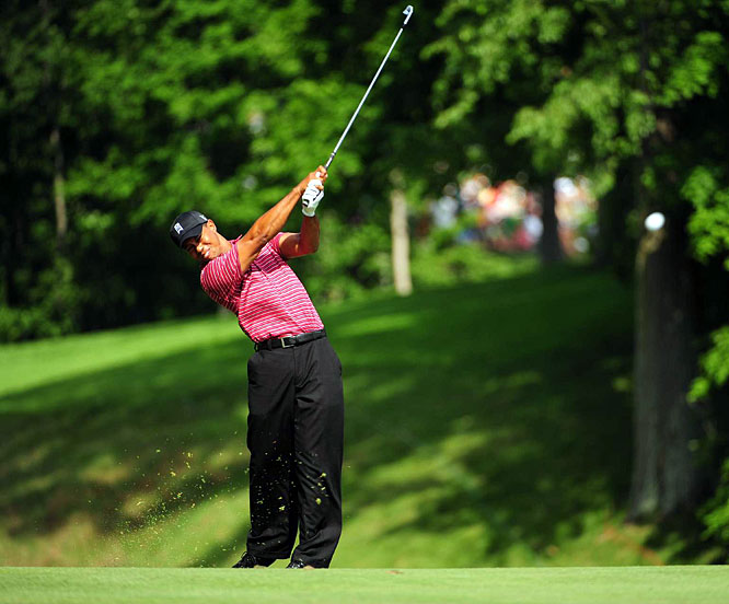 Tiger Woods hits his second shot on the 15th hole during the final round of the Memorial Tournament. Woods shot a 7-under 65 on Sunday and came from four strokes back to win the Memorial for a record-setting fourth time.