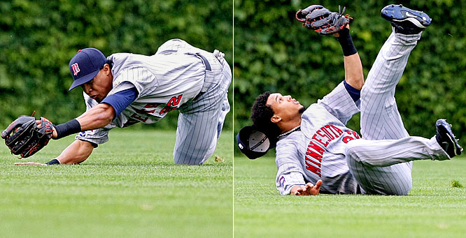 Twins center fielder Carlos Gomez ends up on his back after making a diving catch on a ball hit by Chicago Cubs' Milton Bradley in the first inning. Gomez was also 1-3 from the plate in a 2-0 Minnesota victory.