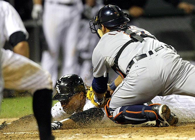 Detroit Tigers catcher Gerald Laird puts the game-saving tag on Chicago White Sox's pinch-runner Dewayne Wise in the ninth inning. The game went to extra innings, where Miguel Cabrera hit a solo shot in the 10th that turned out to be the game-winner as the Tigers beat the White Sox 7-6.