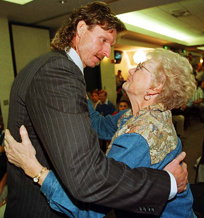 Johnson hugs his mother, Carol, after signing his $54 million deal with the D-Backs.