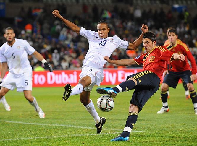 U.S. midfielder Ricardo Clark challenges forward David Villa, who had four of Spain's eight shots on goal.