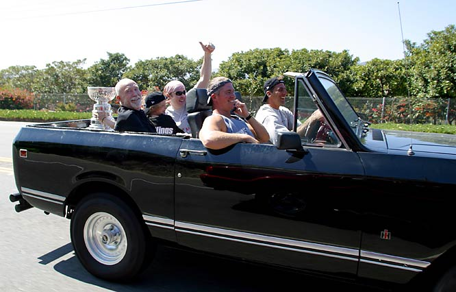 Chris Chelios drives down Pacific Coast Highway 1 in Los Angeles with the Stanley Cup in the back seat with his nine year old daughter Caley, Actor John Cusack gives a thumbs up from the backseat.