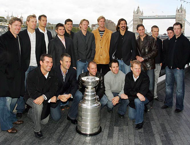 Members of the 2007 champion Anaheim Ducks pose with the Stanley Cup near Tower Bridge in London.