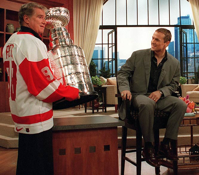 Regis Philbin lifts the Stanley Cup as Detroit captain Steve Yzerman looks on. This photo was taken days after the Red Wings won the 1998 championship.