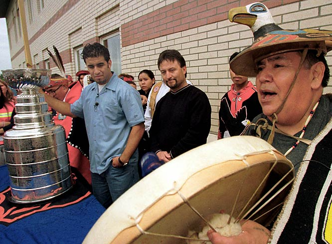 Anchorage native Scott Gomez and his father, Carlos, watch as tribal leader David Katzeek sings a blessing song at the Alaska Native Medical Center in Anchorage. This marked the first time the Stanley Cup had visited Alaska after Gomez and the Devils took home the 2000 championship.