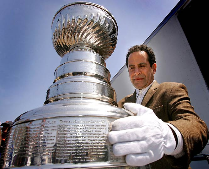 "Actor Tony Shalhoub poses with the NHL Stanley Cup on the set of ""Monk."""