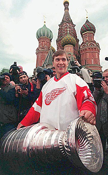 Detroit's Vyacheslav Kozlov holds the Cup in front of St. Basil's Cathedral on Moscow's Red Square.