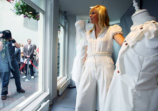 During a break from Wimbledon preparations, Sharapova made headlines posing in the window of a London department store in support of a young fashion student who designed a dress that blinks when the wearer's cell phone rings.