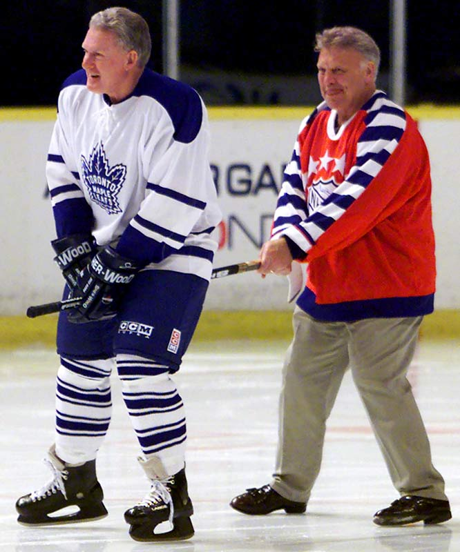 In 1955, Hillman (in white, pictured with Bobby Hull in 2000) won his first of six Stanley Cups at the age of 18 years, and 2 months while a member of the Detroit Red Wings. The former defenseman can breathe easy; Under current NHL rules, a player must turn 18 by September 15 to be eligible to play in NHL that season, which means Hillman's record can not be broken.