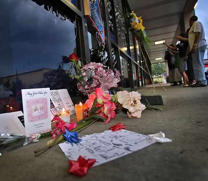 Fans leave flowers and tributes at Steve McNair's Gridiron 9 in Nashville, Tenn., on Saturday, July 4, 2009 after the NFL quarterback was found dead.