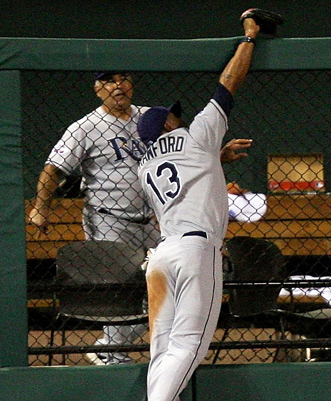 Carl Crawford robs Colorado's Brad Hawpe of a home run in the seventh inning to preserve a 3-3 tie.