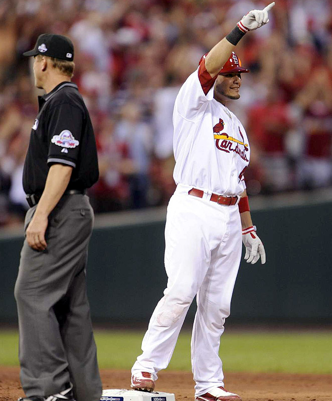 Cardinals catcher Yadier Molina celebrates his run-scoring single in the second that tied the game 2-2.