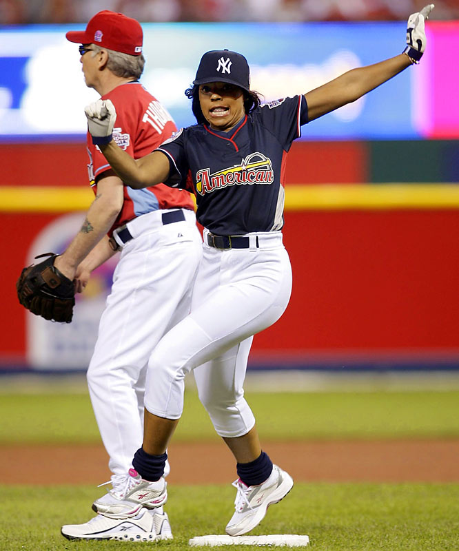 Singer Ashanti barrels around the bases to score for the American League team.