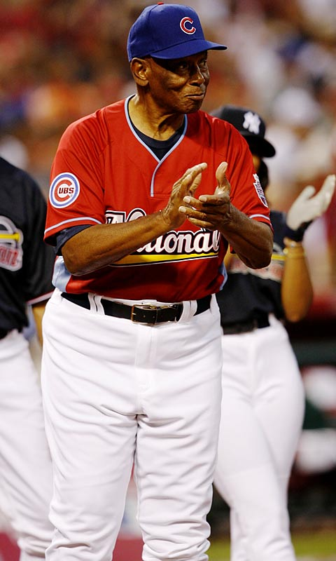 Cubs legend Ernie Banks cheers on his National League team.