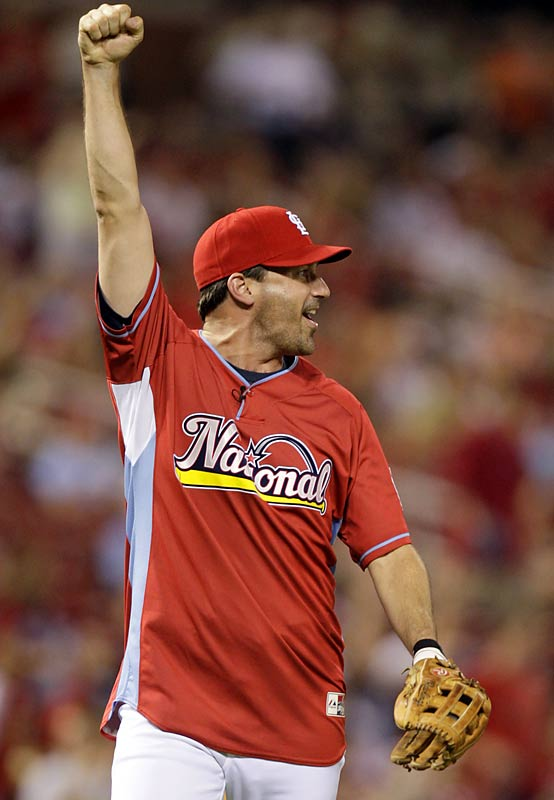Actor and lifelong Cardinals fan Jon Hamm celebrates an impressive catch by teammate Nelly.