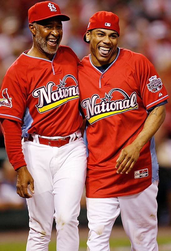 Hall of Famer Ozzie Smith congratulates Nelly on his home run.