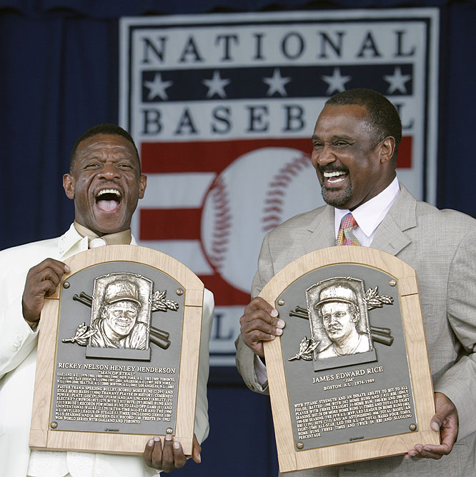 Former left fielders Rickey Henderson (left) and Jim Rice were inducted into the Baseball Hall of Fame on Sunday along with the late Joe Gordon.